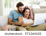 couple sitting on sofa and... | Shutterstock . vector #571264102