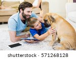 father and son playing with a... | Shutterstock . vector #571268128