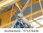 rope access irata worker | Shutterstock . vector #571276636