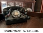 antique old telephone | Shutterstock . vector #571313386