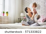 happy loving family. young... | Shutterstock . vector #571333822