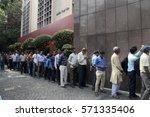 people wait in long queue at... | Shutterstock . vector #571335406