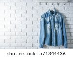 Denim Shirt Hanging On Brick...