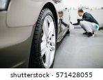 a man cleaning car  car... | Shutterstock . vector #571428055