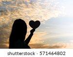 silhouette of women hands... | Shutterstock . vector #571464802