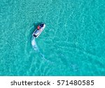 people are playing a jet ski in ... | Shutterstock . vector #571480585