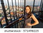 woman is posing with hamburg... | Shutterstock . vector #571498225