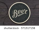 coaster for beer with hand... | Shutterstock .eps vector #571517158