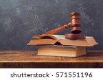 open law book with judges gavel ... | Shutterstock . vector #571551196