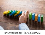 person hand stopping falling...   Shutterstock . vector #571668922