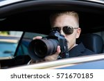 private detective sitting... | Shutterstock . vector #571670185