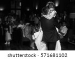 wedding couple performing first ... | Shutterstock . vector #571681102