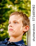 close up of a boy with pensive... | Shutterstock . vector #571685482