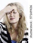 young lady with headache the morning after - stock photo