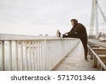 young man in sportswear. guy... | Shutterstock . vector #571701346