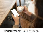 woman holding phone and coffee...   Shutterstock . vector #571710976