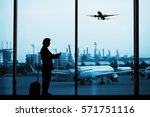 man in airport with luggage and ... | Shutterstock . vector #571751116