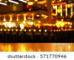 wood table with blur city light ... | Shutterstock . vector #571770946