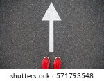 sneakers on the asphalt road... | Shutterstock . vector #571793548