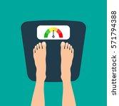 feet on weighting machine | Shutterstock .eps vector #571794388