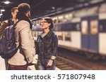commuters waiting for train | Shutterstock . vector #571807948