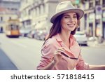 fashionably dressed woman on... | Shutterstock . vector #571818415