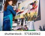 girl in painting studio   Shutterstock . vector #571820062