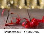 heart shape ribbon in front of... | Shutterstock . vector #571820902
