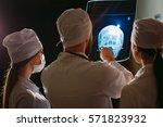 doctors watching x ray of... | Shutterstock . vector #571823932