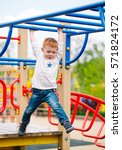 little boy playing on the... | Shutterstock . vector #571824172