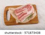 raw sliced bacon with thyme... | Shutterstock . vector #571873438