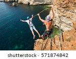 rope jumping off a cliff with a ...   Shutterstock . vector #571874842