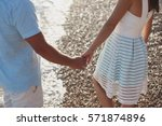 Couple Holding Hands Walking O...