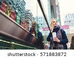 charming young blonde business... | Shutterstock . vector #571883872