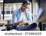 handsome male freelancer writer ... | Shutterstock . vector #571884235