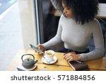 skilled female afro american... | Shutterstock . vector #571884856