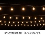 garlands of lamps on a wooden... | Shutterstock . vector #571890796