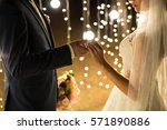 evening wedding ceremony. the... | Shutterstock . vector #571890886