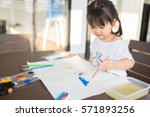 little asian girl painting with ... | Shutterstock . vector #571893256
