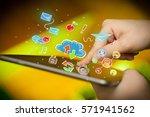 female hands touching tablet... | Shutterstock . vector #571941562