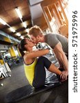 couple in love kissing in gym | Shutterstock . vector #571975996