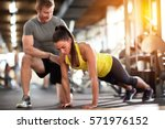 tired sportswoman doing pushups ... | Shutterstock . vector #571976152