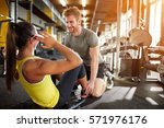 fitness training with trainer... | Shutterstock . vector #571976176