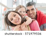 young happy family in shopping... | Shutterstock . vector #571979536
