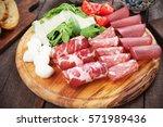 charcuterie board with italian... | Shutterstock . vector #571989436