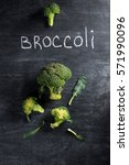 top view photo of broccoli over ... | Shutterstock . vector #571990096