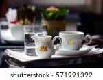 cup of coffee  milk pot  a... | Shutterstock . vector #571991392