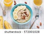 bowl of oatmeal porridge with... | Shutterstock . vector #572001028