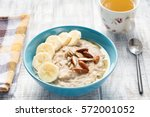 oatmeal porridge bowl with... | Shutterstock . vector #572001052