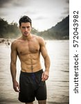 half body shot of a handsome... | Shutterstock . vector #572043982